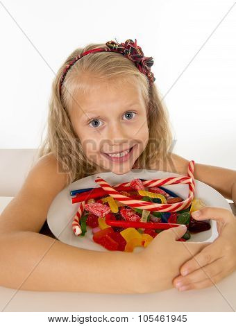 Pretty Little Female Child Eating Dish Full Of Candy Caramel And Sweet Food In Sugar Abuse And Unhea