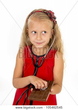 Pretty Little Female Child With Stethoscope On Chocolate Bar Looking Worried In Unhealthy Nutrition