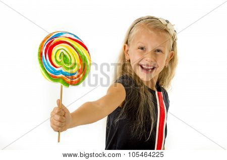 Beautiful Little Female Child With Sweet Blue Eyes Holding Huge Lollipop Spiral Candy Smiling Happy
