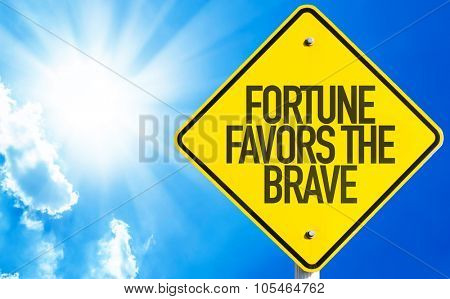 Fortune Favors the Brave sign with sky background