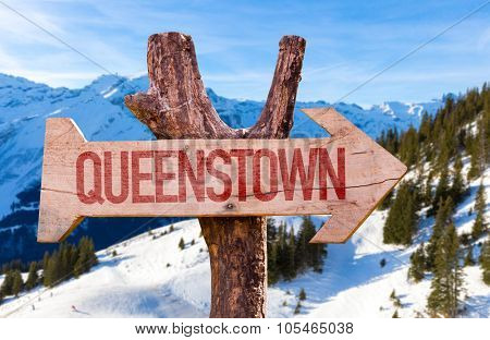 Queenstown wooden sign with winter background