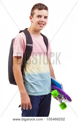 Portrait of a school boy holding a skateboard and notebooks, isolated on white