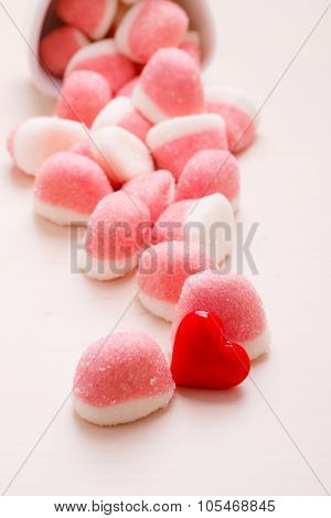 Pink Jellies Or Marshmallows With Sugar On Table