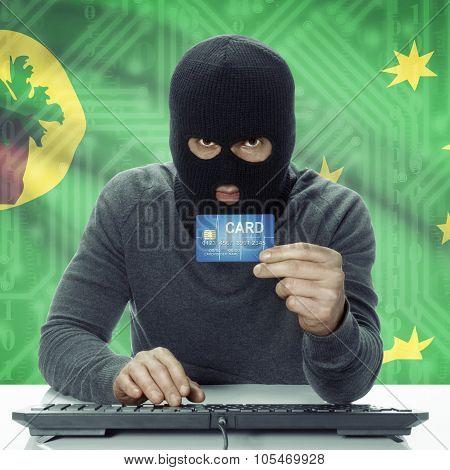 Dark-skinned Hacker With Flag On Background Holding Credit Card - Cocos (keeling) Islands