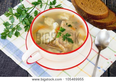 Soup With Fresh Fish And Dumplings In A Rustic Style