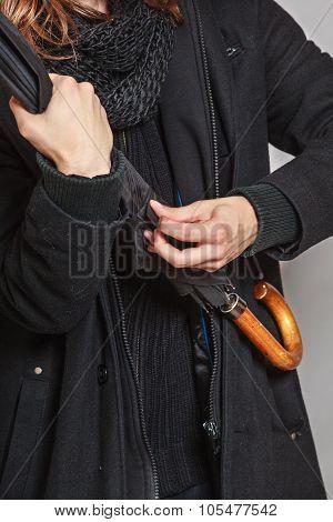 Closeup Of Fashion Man Wearing Black Coat.