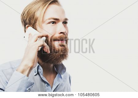 tehnology, internet, emotional  and people concept: young bearded man talking on mobile isolated on white background.Special Fashionable toning.