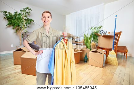 Maid woman with clothing. House cleaning service concept.