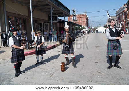 Galveston, Tx/usa - 12 06 2014: Men Dressed As Scottish Musicians Play Harp At Dickens On The Strand
