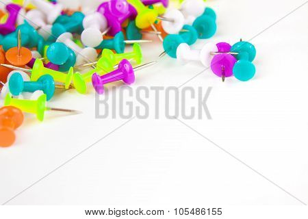 Colored Thumbtacks On A White Background