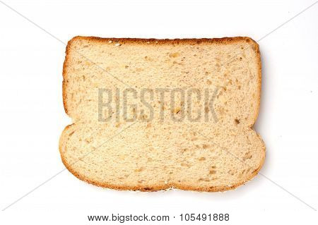 overhead view of a slice of whole grain oatnut bread isolated on white background