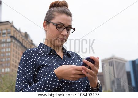 Young Professional Woman Texting In The City