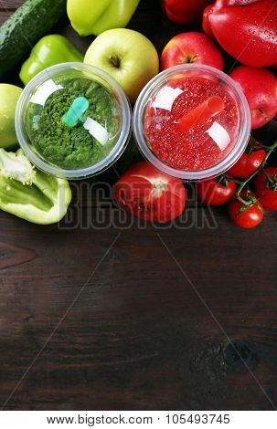 Fresh juice mix fruit, healthy drinks in plastic cups on wooden background