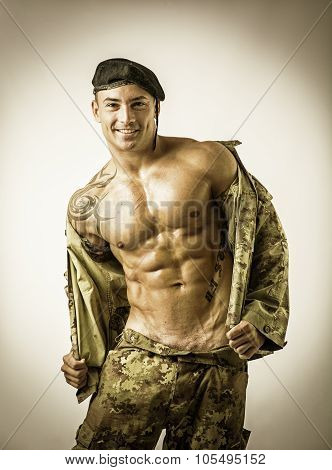 Muscular Man in Camo Pants and Jacket
