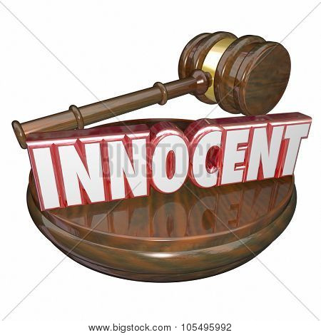 Innocent word in red 3d letters on a wood judge gavel and block to announce a final verdict or decision finding a defendant not guilty
