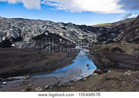 Vatnajokull glacier covered with volcanic ash is melting