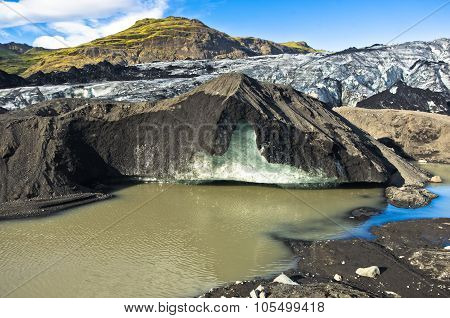 Vatnajokull glacier covered with volcanic ash is melting