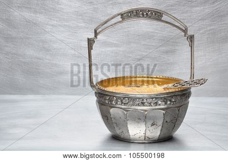 Silver-plated sugar bowl with spoon