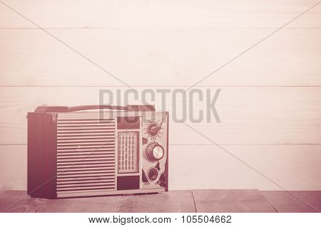 Old Transistor Radio On Wooden Background, Made With Color Filters,blurred Focus. Retro Style.