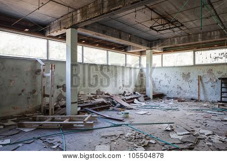 Hall With Concrete Columns And Broken Windows