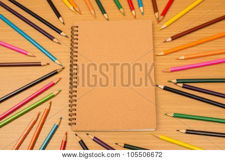 Multi Colored Pencils And Notebook With Text Space