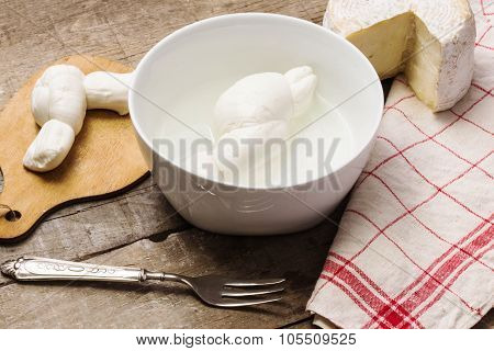 Mozzarella And Caciotta Over Rustic Table