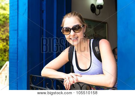 Happy tourist on the window in Ouro Preto, Minas Gerais, Brazil