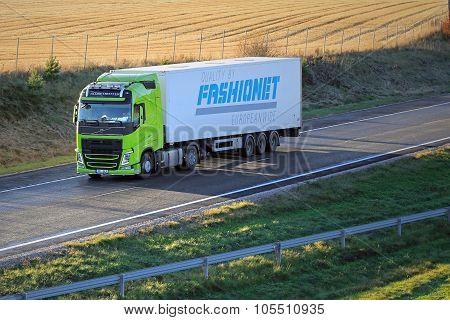 Lime Green Volvo FH Semi Truck On Motorway