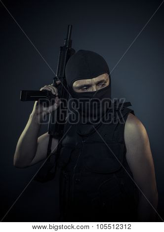 Thug, terrorist carrying a machine gun and balaclava