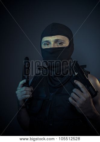 Danger, terrorist carrying a machine gun and balaclava
