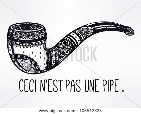 Smoking pipe with quote in French.