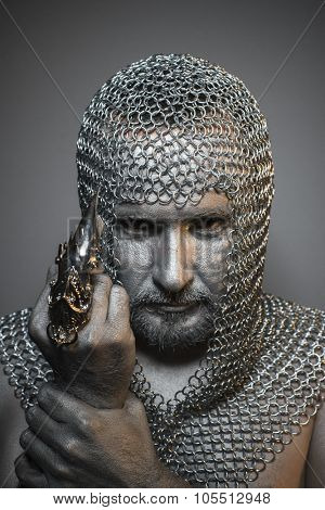 Protection, man in chain mail and leather painted silver, medieval warrior