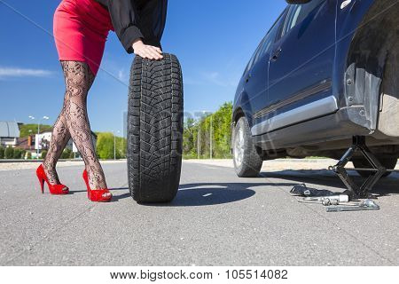 Sexually dressed woman repairing car