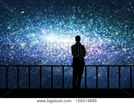 Silhouette of young man in the cosmos