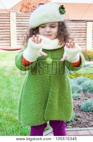 Girl In Clothes Hand Knitted