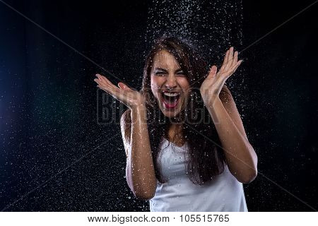 Young brunette and drops of water