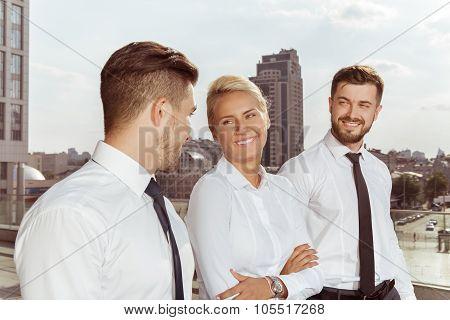 Three business partners having conversation