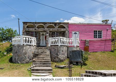Old Shack Of Concrete Blocks And Pink Boards