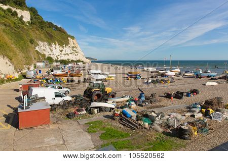 Beer beach Devon England UK with boats people and fishing equipment on the Jurassic Coast a World He