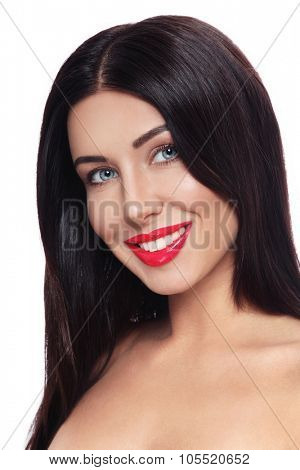 Portrait of beautiful happy smiling brunette with glossy red lipstick over white background