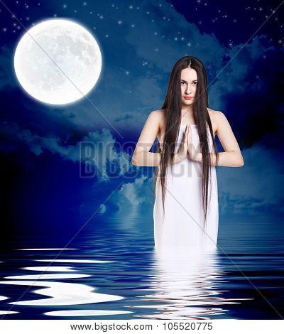 Woman in white shirt pray
