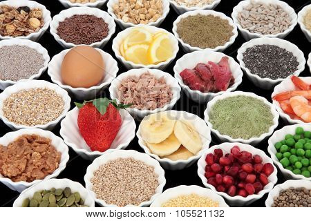 Health and body building high protein super food of meat, fish and dairy, with supplement powders, seeds, cereals, grains, fruit and vegetables.