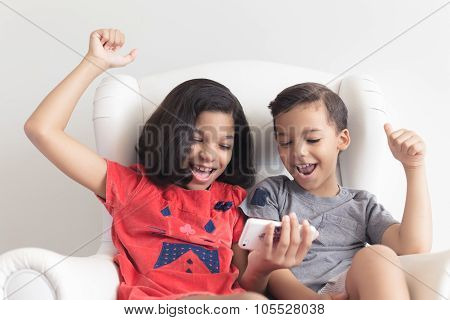 Boy and girl playing on mobile