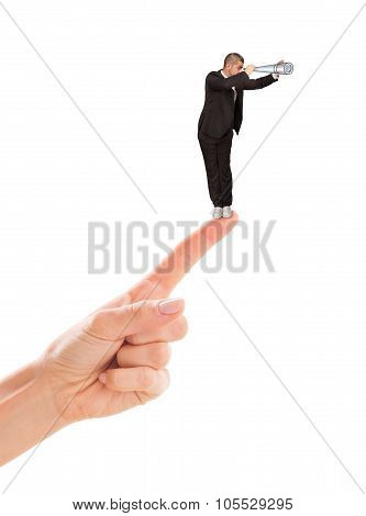 Businessman standing on woman's point finger