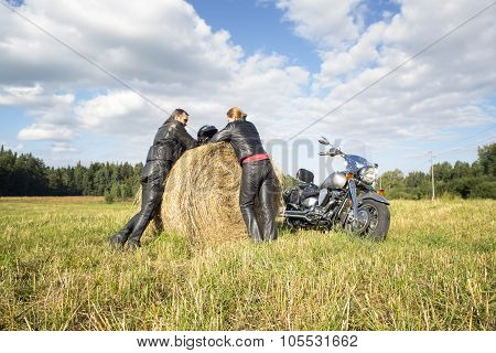 Couple Of Motorcyclists Resting Outside The City