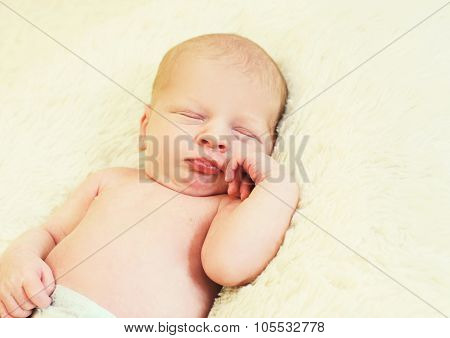 Portrait Of Cute Baby Sleeping On Bed At Home
