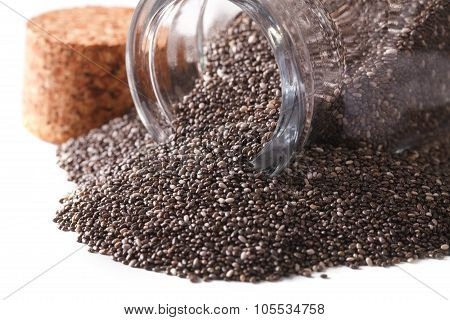 Selected Chia Seeds Spill Out Of A Jar Macro Isolated On White. Horizontal