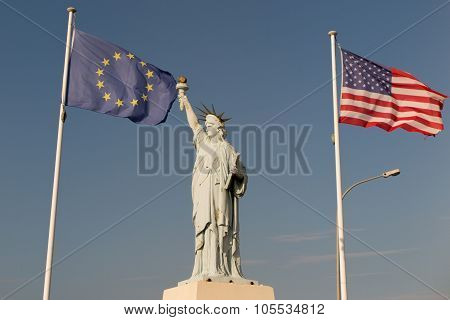 Usa And European Union Flags, Alliance.  Statue Of Liberty, Blue Sky Background.