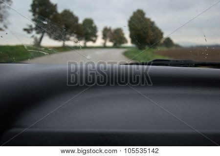 Driving - A View Of A Country Road Through The Windscreen