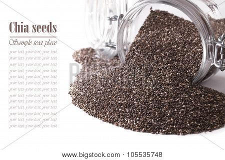 Chia Seeds Close-up Spill Out Of A Glass Jar Isolated On White. Horizontal